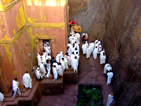 Pilgrims leaving the church (via http://bigtubofgoo.blogspot.ie/2008/04/lalibela-ethiopia-running-out-of-pseudo.html)