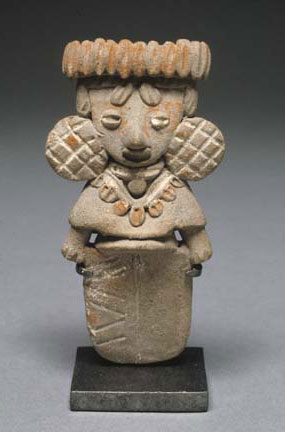 female_figurine_with_large_earspools_and_unified_lower_body